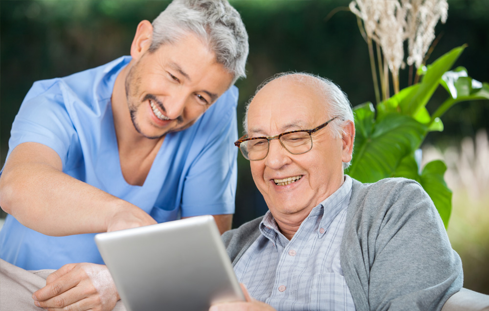 Son and father navigation tthe Providence HomeCare website from their tablet
